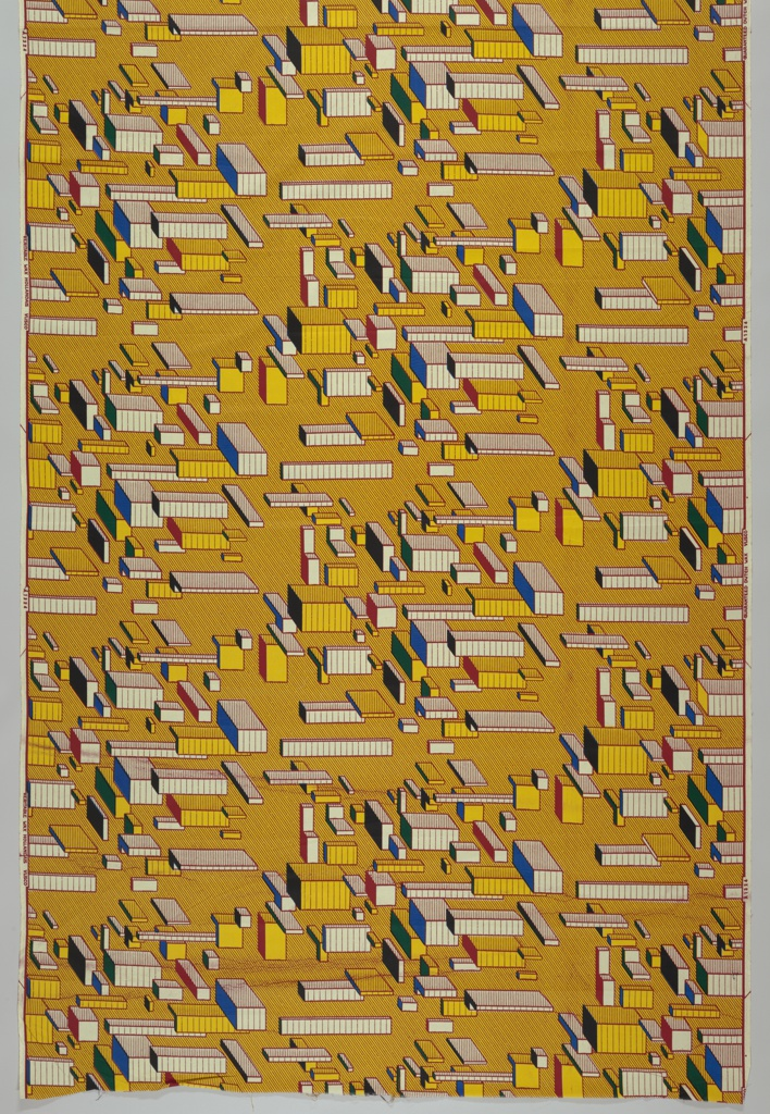 Blocks printed on yellow and red diagonally striped background.