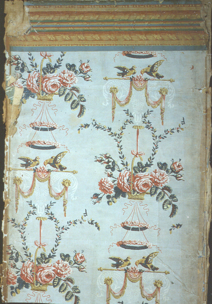 Arabesque with 2 birds (doves?) and floral baskets (roses?), with another layer of rainbow or irise wallpaper below and linen lining.  Printed in polychrome with gray-blue ground.