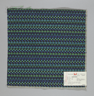 Black warp and weft with supplementary wefts in purple, green and blue, forming diamonds, squares and triangles. Serged on two sides and cut on two sides.