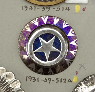 steel buttons with decoration in blue tinting - a/: border, tinted blue with  triangles left in steel; center painted blue, over which is a disc of steel cut to show a star within a circle - b/: eight-pointed star and central disc, tinted blue - c/: disc with square in blue tint, set on pearl shell discs in buttons with raised steel rims.