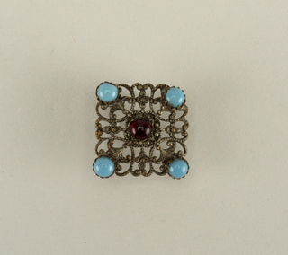 two buttons of silver filigree set with pieces of colored glass - b/: convex button; turquoise in top; red, blue, green and purple glass in sides - c/: flat button with red glass in center, a turquoise at each corner.