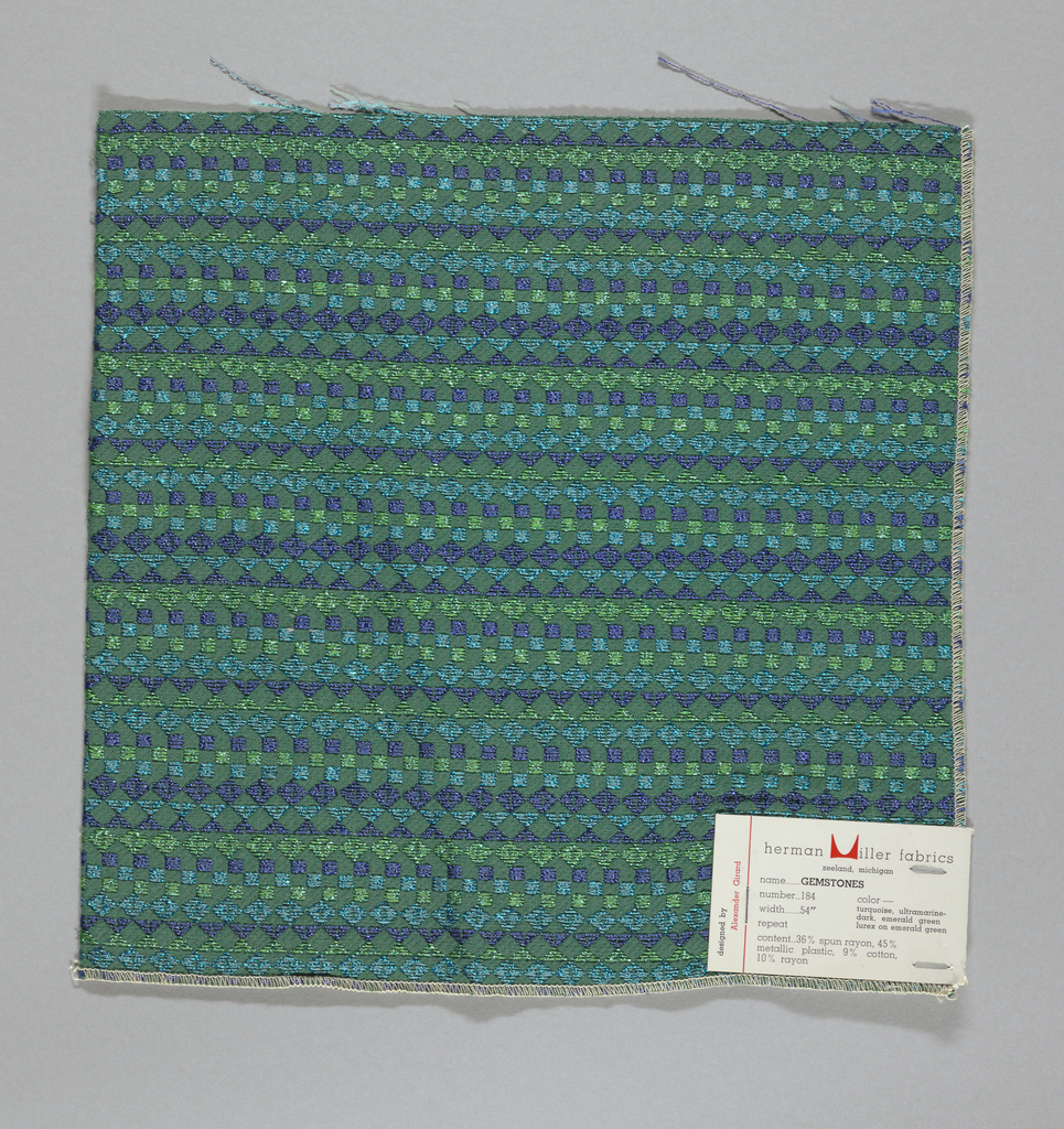 Green warp and weft with supplementary wefts in blue, green and purple, forming diamonds, squares and triangles.