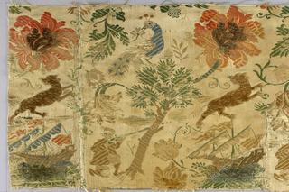 "Fragments of a pattern which included within one repeat a ship at sea, flowering trees, man kneeling aiming gun at feline animal, seated man smoking pipe, and a peacock. Multi-colors on cream background. Chenille used for may details or entire motifs.  At least two intervals a narrow 1 3/8"" band interrupted the pattern for a border at top and bottom. A small section of the repeated pattern was used for the border band."