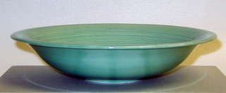 Blue- green, round dish.