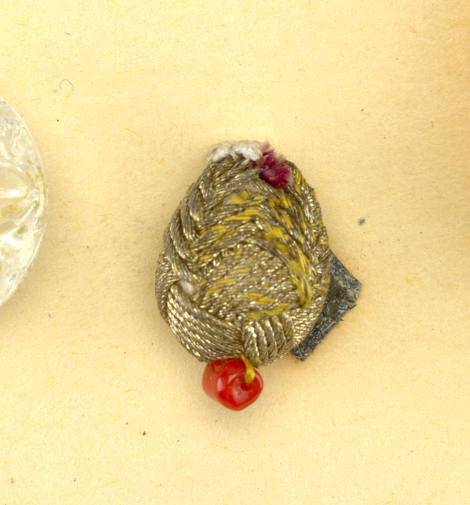 Component -c is on card 15; Component -d is on card 2 Six pear-shaped buttons wrapped with gold metal thread, each trimmed with four clusters of coral beads about largest circumference and one cluster at tip.