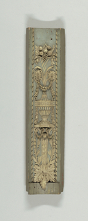 Two lower motifs of pilasters, curved in plan, painted white and blue.  Vase on console carved in relief, crowned by a cornucopia containing various fruits.