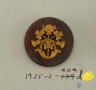 Four circular buttons of shell, with composition in design of spray composed of rose, shamrock and thistle.  On card 2