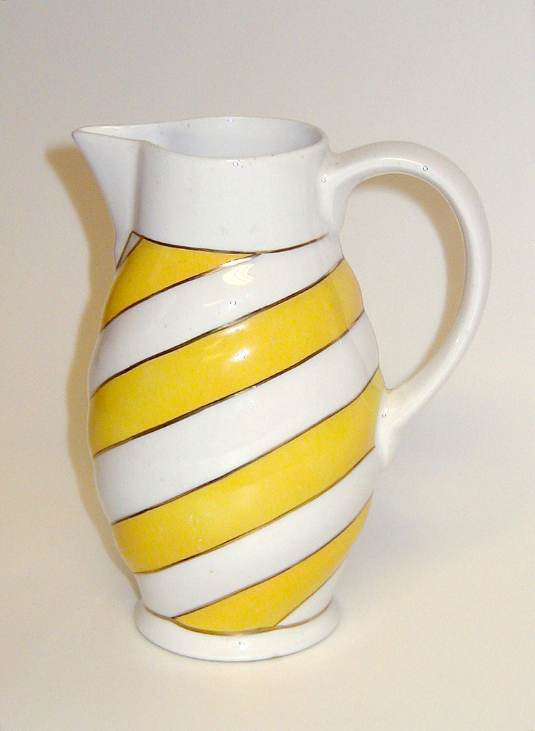 Oval body, with angled yellow and white stripes. The mouth and spout are white, as is the curved handle.