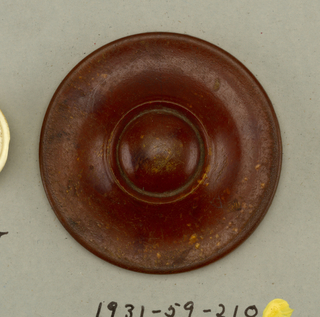 Button of an animal's hoof; moulded; central section convex with surrounding, slightly concave, band. Brass shank.  On card 2