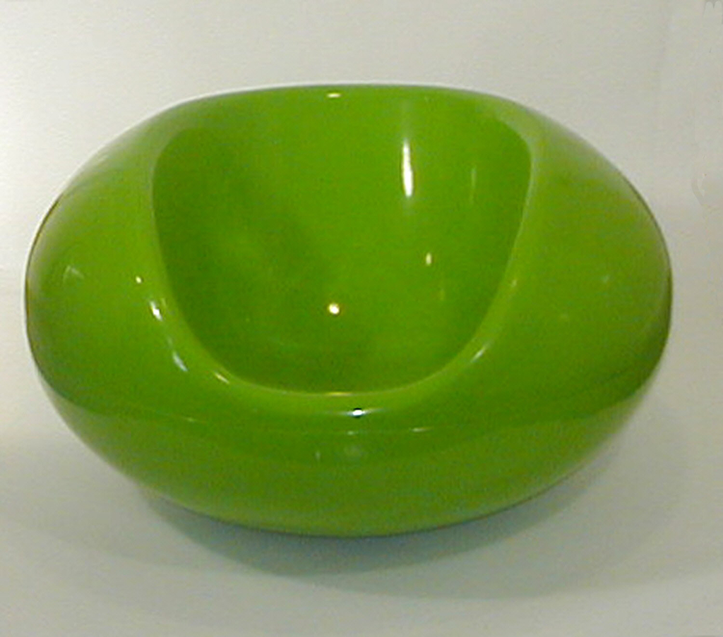 Bright green flattened spherical shape, with seat section cupped out.