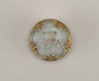 buttons with molded and painted ornament; gilt scrolls at the edge with floral sprays in center; double brass shank.