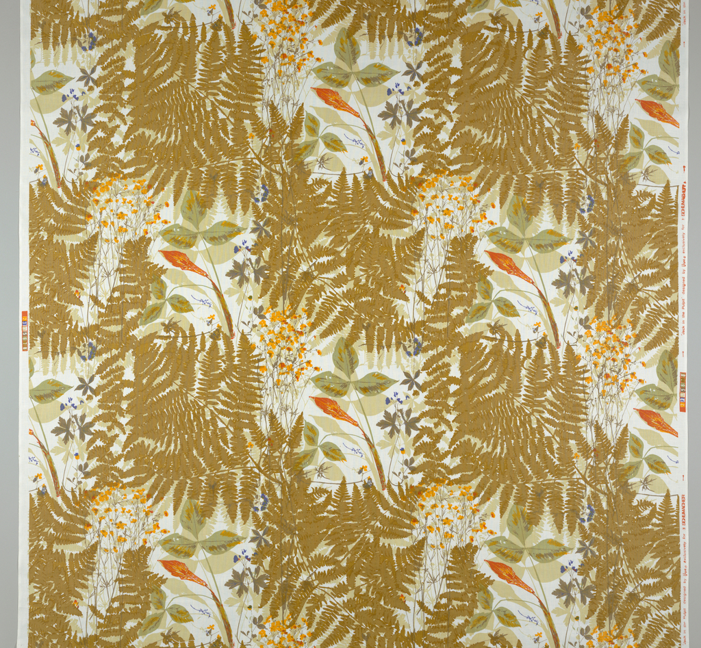 Multi layers of ferns and wild flowers featuring the Jack in the Pulpit. Muted colors on a white background. Lengths of fabric placed side by side continue pattern. Original design dates to 1949.
