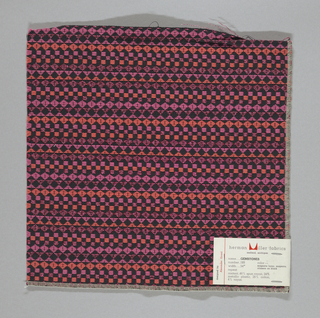 Black warp and weft with supplementary wefts in pink, metallic pink and orange, forming diamonds, squares and triangles. Serged on 2 sides and cut on 2 sides.