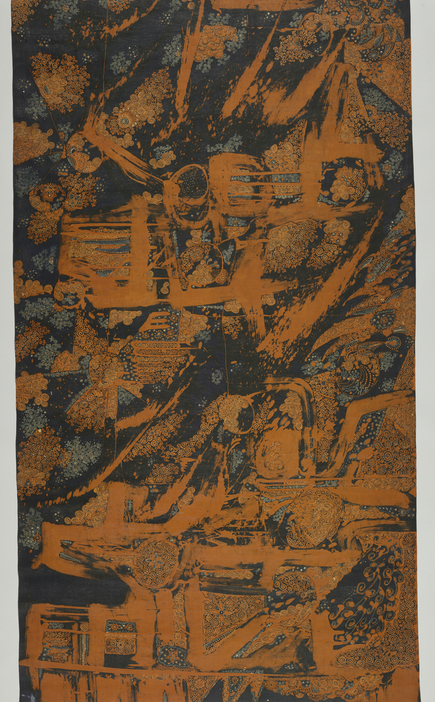 An abstract patterned batik textile in indigo and brown/rust colors with bold brush strokes and traditional fine dots.