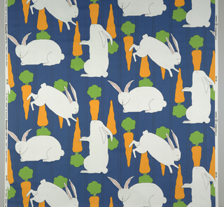 Printed textile with white rabbits in three positions and orange carrots with green tops, on a blue ground.