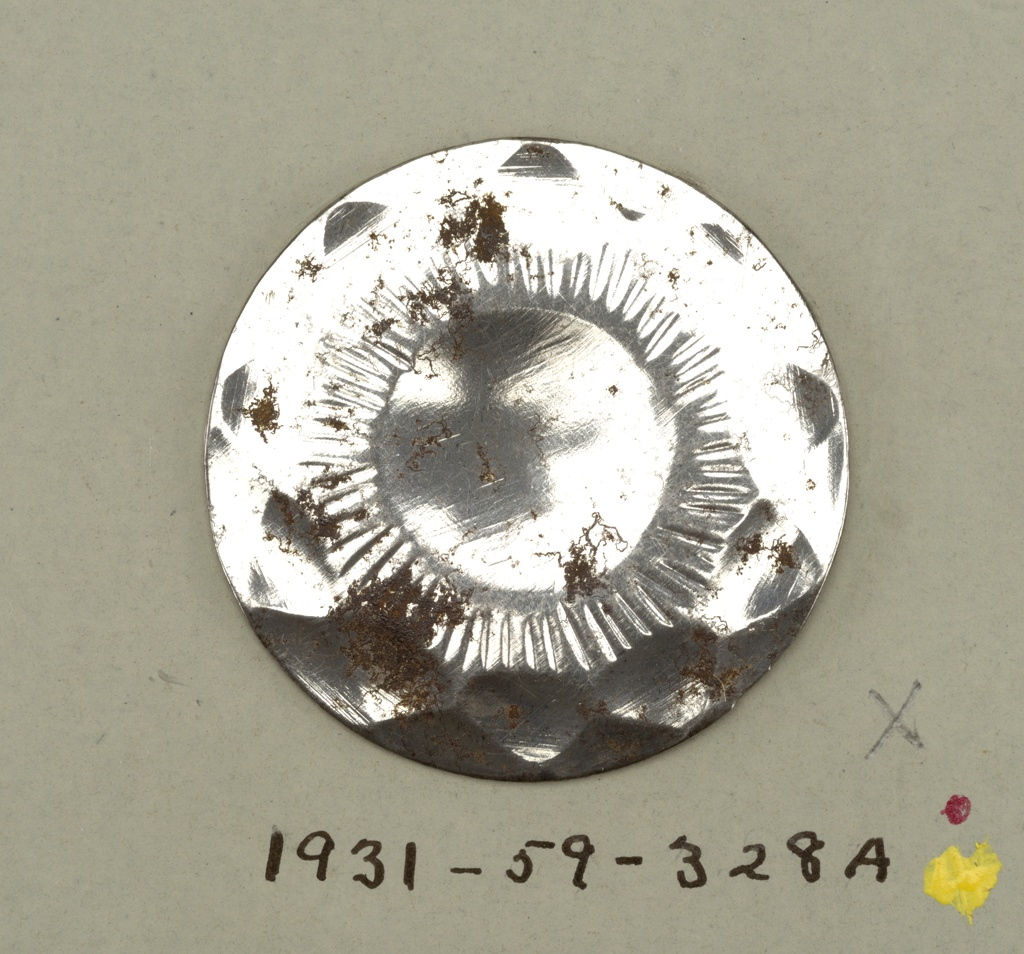 flat, circular buttons with ornament representing ten petalled flower, conventionalized.  Component -a is on card 66 Component -b is on card 59