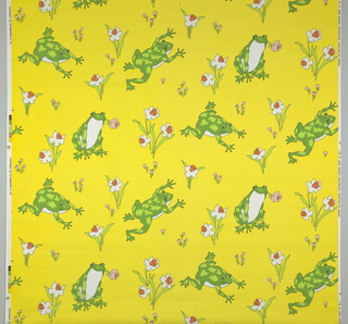 Half drop repeat of three bright green frogs surrounded by jonquils on a bright yellow background. Two frogs are hopping and the other sits with a pink flower in its mouth. Lengths of fabric placed side by side continue pattern.