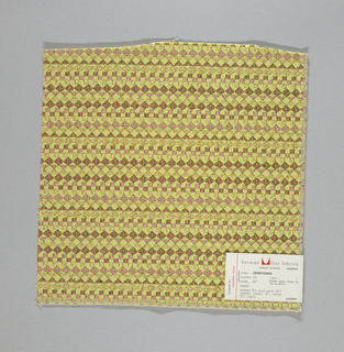 Yellow-green warp and weft with supplementary weft in shades of cooper and gold colors, forming diamonds, squares and triangles. Serged on two sides and cut on two sides.