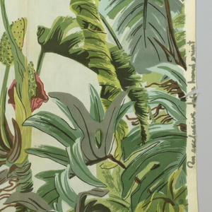 A design of large, overlapping tropical leaves and flowers, printed in pink, brown and several greens on a cream ground.