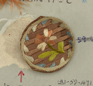 buttons made of wooden molds covered with tan silk embroidered in pink and tan silk in design of open flower.  Component -a is on card A Component -b is on card 15 and is not labeled with a component
