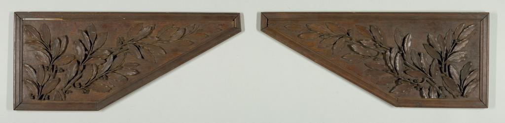 Four polygonal panels carved with laurel - set in simple moulded frames.