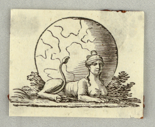 Sphinx crouching before a sphere, on a meadow.