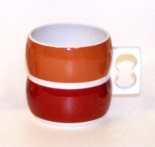 Cylindrical body formed of  two convex sections, one above the other, white pierced rectangular handle on side; white body, exterior of top section glazed in orange, bottom section in cinnamon-brown.