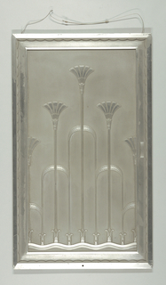 Sliding door; vertical rectangle with relief pattern of stylized lotus flowers and water.