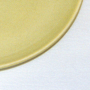 "Circular form, raised edge at rim; ""avocado"" yellow- green glaze."