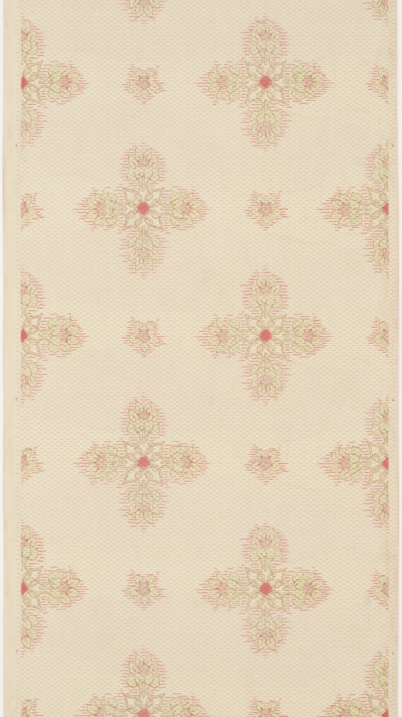 Cross-shaped floral motifs composed of light green, red, and lavender leaves and flowers, small flowers interspersed, on tan ground.