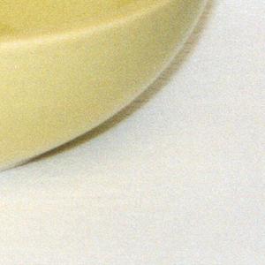 "Hemispherical form; ""avocado"" yellow-green glaze."