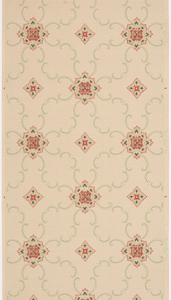 On a beige ground, rhomboid shaped medallions in red, black, brown and green with arabesques.