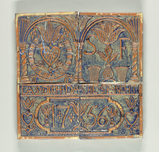 Pressed terracotta with raised ornament and blue glaze. A) has arch with heart and flowers in rayed circle. B) has arch enclosing stylized flowers and letters SF. A) and D) have cartouche with date 1756 and top inscription: Las dich das bese nicht (Be not overcome by evil.) Modeled after an eighteenth century Pennsylvania German cast iron stove designs.