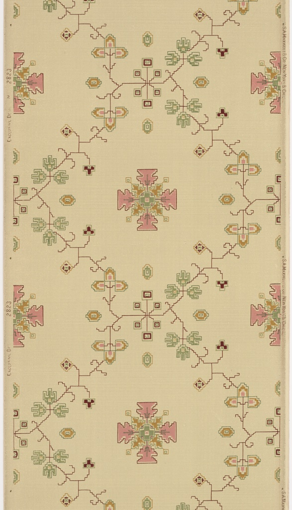 On tan ground, red thin trellis pattern with jagged edges and cross-shaped medallions in pink and mustard orange. Printed on tan ground.
