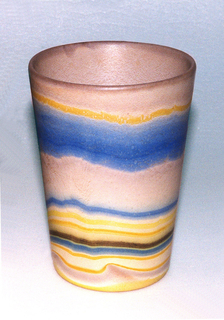 Straight slightly flared beaker decorated with brushed lines in pink, yellow, and blue.