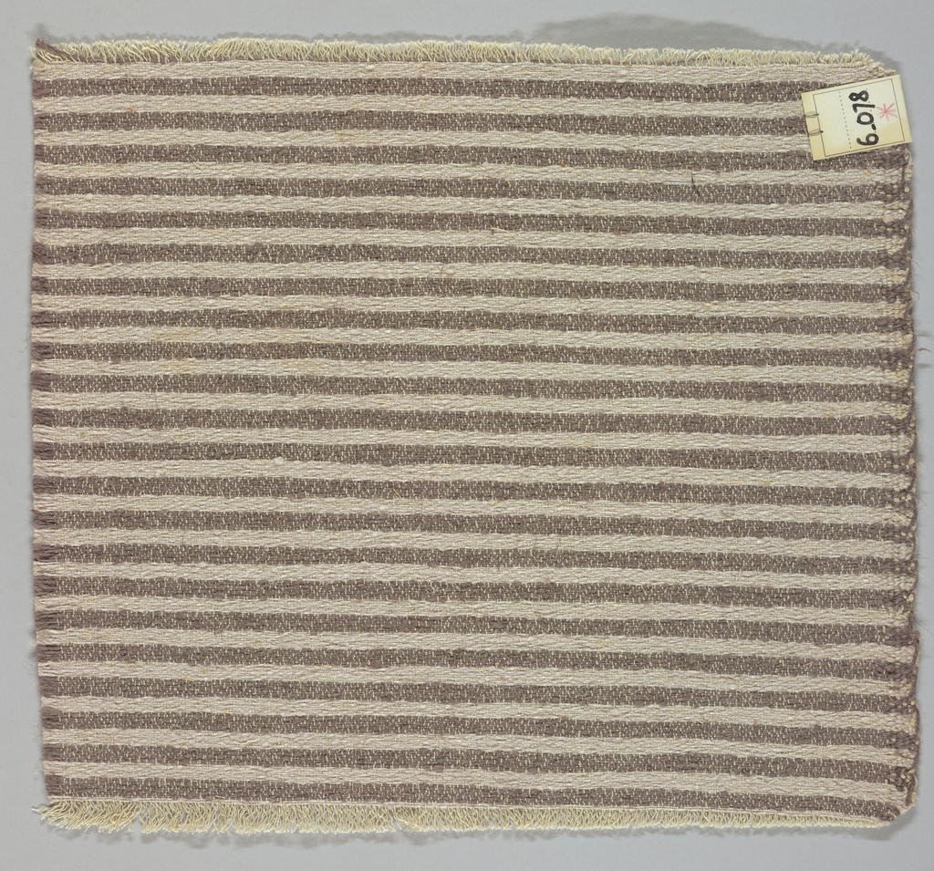 Heavy plain weave in narrow horizontal stripes of beige and brown. Warp is comprised of lightweight threads in off-white while the weft has heavier threads in beige and brown.