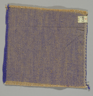 Tweed effect plain weave in blue, beige and light brown. The paired warps are beige and light brown while the weft is comprised of heavy two-ply blue yarns.