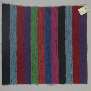 Plain weave in even vertical stripes of light blue, red, violet, green, crimson, blue, pink and black. Weft threads are black. Number 540.