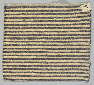 Heavy plain weave in narrow horizontal stripes of black and pale gold. Warp is comprised of lightweight threads in beige while the weft has heavier threads in black and pale gold.