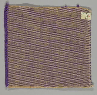 Tweed effect plain weave in violet, beige and light brown. The paired warps are beige and light brown while the weft is comprised of heavy two-ply violet yarns.