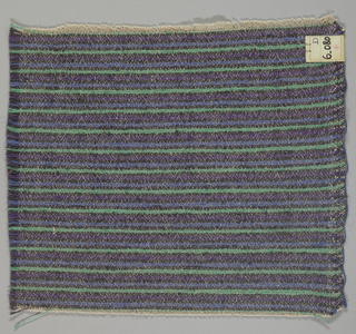 Heavy plain weave in thin horizontal stripes of blue, violet, green and black. Warp is comprised of lightweight threads in light brown while the weft has heavier threads in blue, violet, green and black.