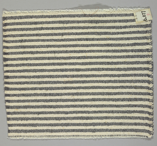 Heavy plain weave in narrow horizontal stripes of white and dark grey. Warp is comprised of lightweight threads in white while the weft has heavier threads in white and dark grey.