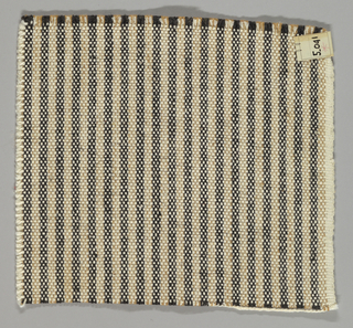 Vertically striped plain weave in black, light brown and white. Warp threads are black, light brown and white. Weft threads are white.