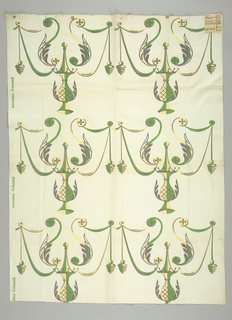 Printed textile with repeating green and yellow pattern showing an ornamented vase form with acanthus leaves, swags and hanging pinecones
