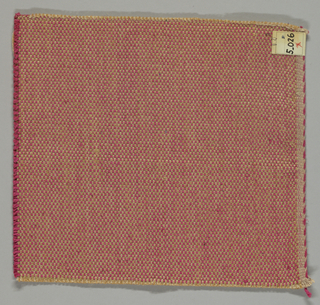 Tweed effect plain weave in dark pink, beige and light brown. The paired warps are beige and light brown while the weft is comprised of heavy two-ply dark pink yarns.