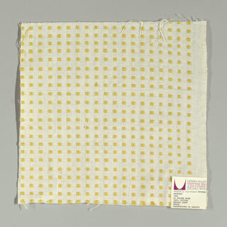 White plain weave with dark yellow squares. Square patterning is formed by supplementary warp floats.