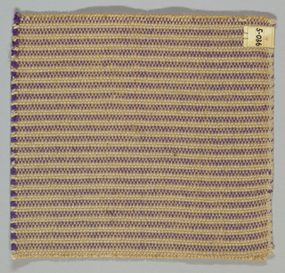 Horizontally striped plain weave with paired warps in shades of violet and light brown. Paired warps are beige and light brown. Weft is comprised of heavy two-ply yarns in violet and beige.