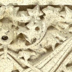 Large square panel of buff-colored terracotta, the surface decorated with one half of vertically oriented design of abstract vegetal motif in lonzenge shape (to be set below similar panel to complete design).