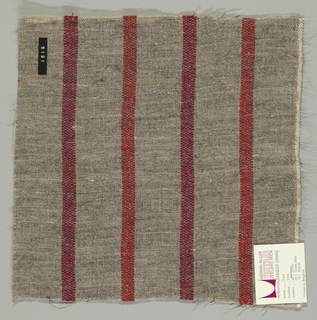 Plain weave of variegated grey and narrow crimson and dark red vertical stripes. The grey striped areas are comprised off-white warps while the wefts are comprised of white threads loosely twisted with black goat hair. The crimson and dark red stripes are made of heavier warp threads with a slight sheen.