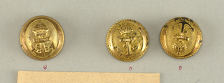 "Convex button with ornament of crowned anchor witin a plain and a rope border - on reverse, ""G and Cie    M18 Paris"" incised coat of arms.  Naval officer.  Component -a is on card F"